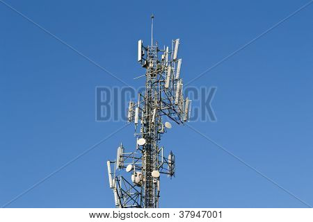 CELL PHONE TOWER ON A BACKGROUND SKY