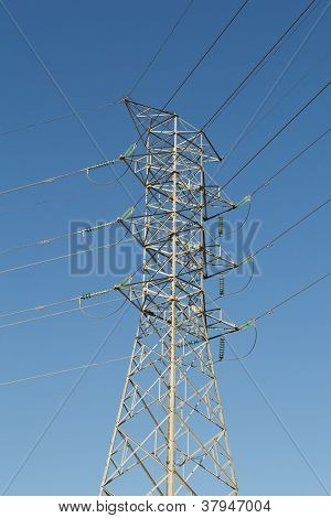 ELECTRICAL POWER TOWER WITH A BLUE SKY
