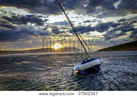 Moored sailboat in heavy winds