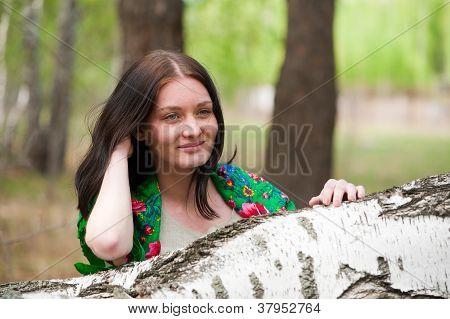 Beautiful woman near birch