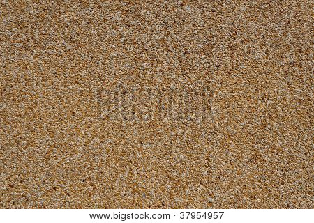 Tiny Gravel Texture On Brown Concrete Wall
