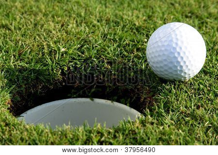 Golf Ball Is Going To Fall In Hole
