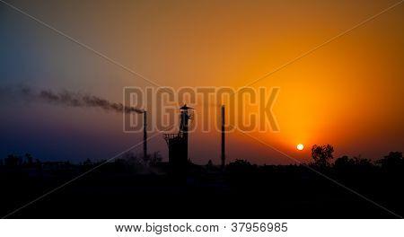 Sun set in industrial area