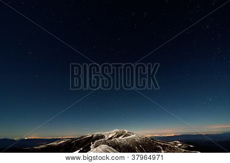 Stars Above Snowy Autumn Mountain Ridges