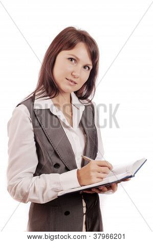 Business woman holding diary and pen