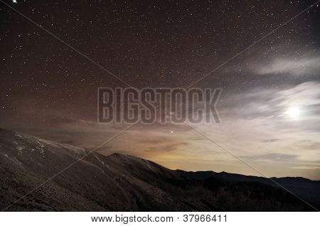 A Mountains Landscape At Night With Moonlight