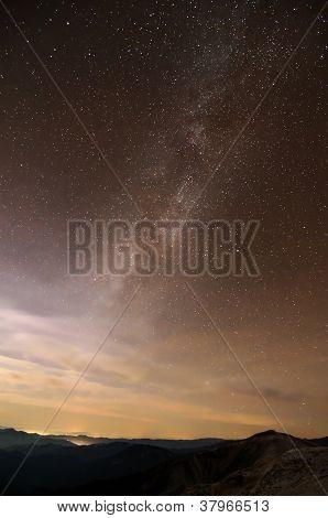 Milky Way Galaxy Over Mountain Ridges