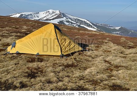 Yellow Tent Upon Snowy Spring Ridges