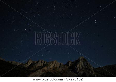 Natural Rocks And Stars At Night
