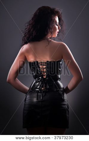 Desired Brunette Woman Posing In Leather Corset