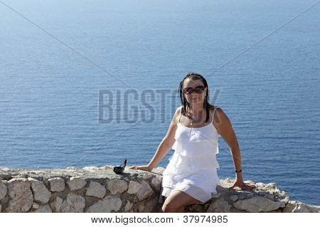 Woman Sitting On Wall Of Castle