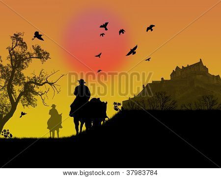 Two Cowboys Silhouette Against A Sunset