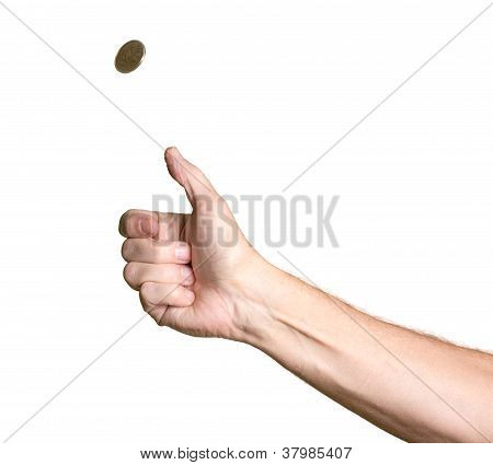 Man's Arm And Hand Tossing Golden Coin