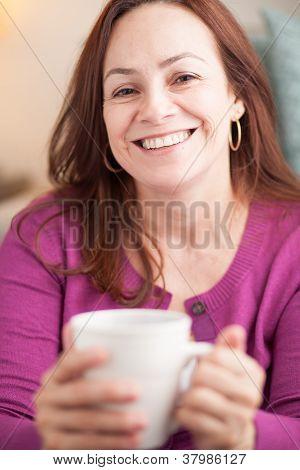 latin woman drinking coffee