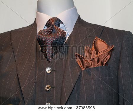 Dark Brown Striped Jacket, Patterned Tie and Tan Handkerchief (Horizontal)