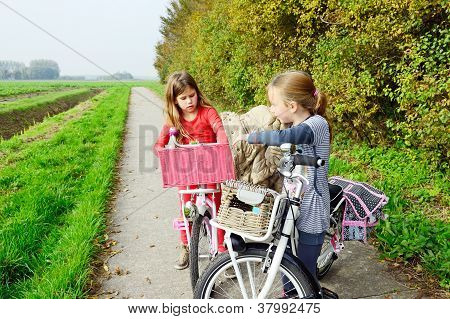 children enjoying nature on bicycle