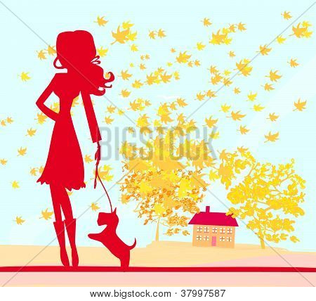 Girl Walking With Her Dog In Autumn Landscape.