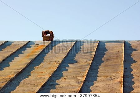 Chimney On An Obsolete Tinny Roof