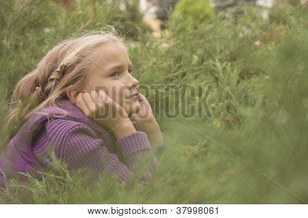 girl playing outdoor in bush in park