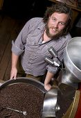 Master Roaster Stands By Beans Drying