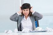pic of nervous breakdown  - Young business woman experiencing nervous breakdown at office - JPG