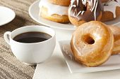 image of donut  - Fresh Homemade Donuts and Coffee against a background - JPG