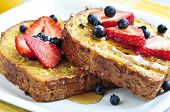 stock photo of maple syrup  - Breakfast of french toast with fresh berries and maple syrup - JPG