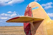 stock photo of propeller plane  - the tail part of the old plane the blue sky background - JPG