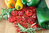 foto of poblano  - Compilation of poblano pepper, scotch bonnet, miniature bell peppers, fresh rosemary, oregano