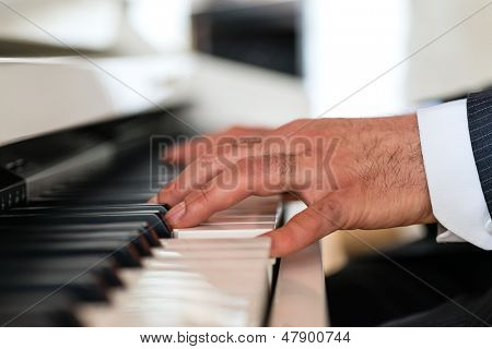Pianist on a piano creates a beautiful musical Atmosphere in a fine dining restaurant