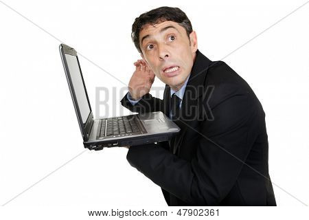 Businessman listening to laptop, isolated on white