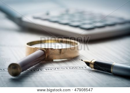 Fountain pen on financial newspaper