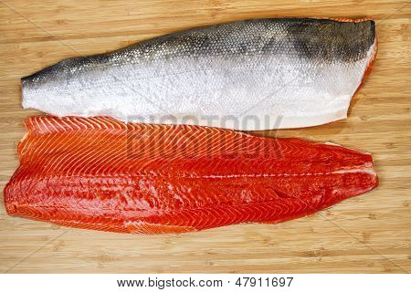 Fresh Red Salmon Fillets On Bambbo Board