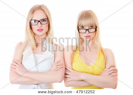 Two Beautiful Young Serious Women In Glasses
