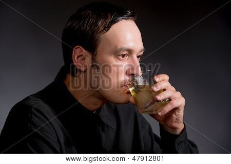 Man Drinking Whiskey