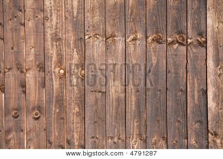 Wooden Fence Treated With Creosote