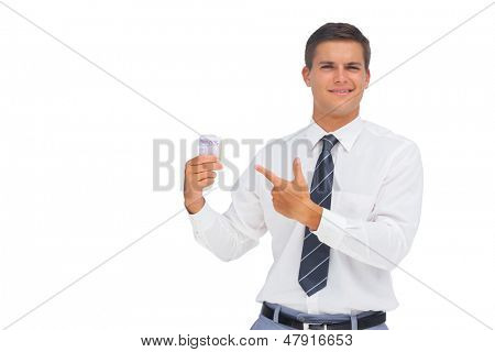 Businessman showing a lot of cash on white background