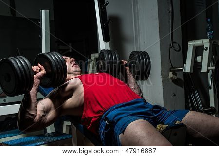 Young Bodybuilder Doing Bench Press For Chest