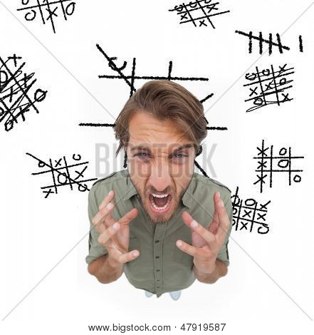 Outraged man gesturing and yelling with noughts and crosses on the background