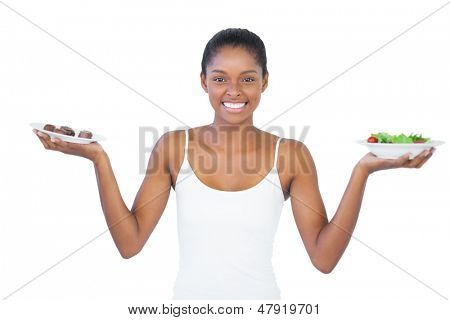 Happy woman deciding to eat healthily or not on white background