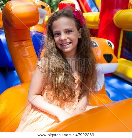 Cute Little Girl Plays In Bouncing Castle