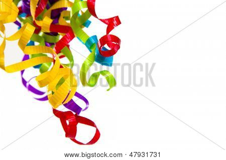 Mult-colored curly ribbons on a white background with copyspace