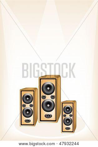 Three Audio Speaker On Brown Stage Background