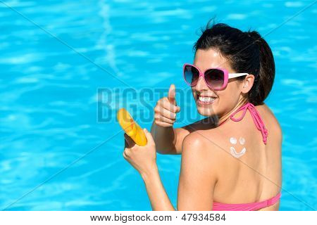 Happy Woman Applying Sunscreen On Summer