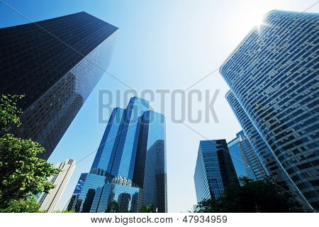 Business skyscrapers, sunny blue sky. La Defense financial district in Paris, France.