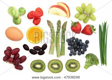 Healthy superfood selection of fresh fruit, vegetables and dairy products over white background.