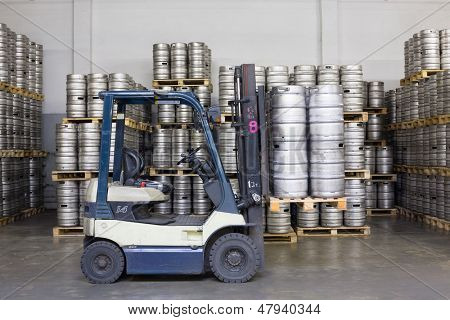 MOSCOW - OCT 16: Forklift with beer kegs in stock brewery Ochakovo on October 16, 2012 in Moscow, Russia. Ochakovo is largest Russian company beer and soft drinks industry without foreign capital.