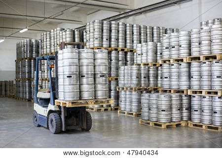 MOSCOW - OCT 16: Autoloader loading beer kegs in stock brewery Ochakovo on Oct 16, 2012 in Moscow, Russia. Ochakovo is largest Russian company beer and soft drinks industry without foreign capital.