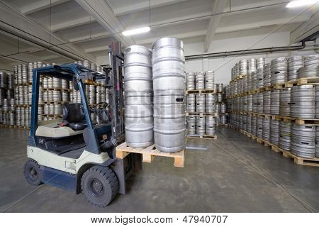 MOSCOW - OCT 16: Forklift loading beer kegs in stock brewery Ochakovo on October 16, 2012 in Moscow, Russia. Ochakovo is largest Russian company beer and soft drinks industry without foreign capital.