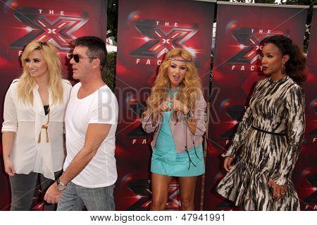 LOS ANGELES - JUL 11:  Demi Lovato, Simon Cowell, Paulina Rubio, Kelly Rowland at the